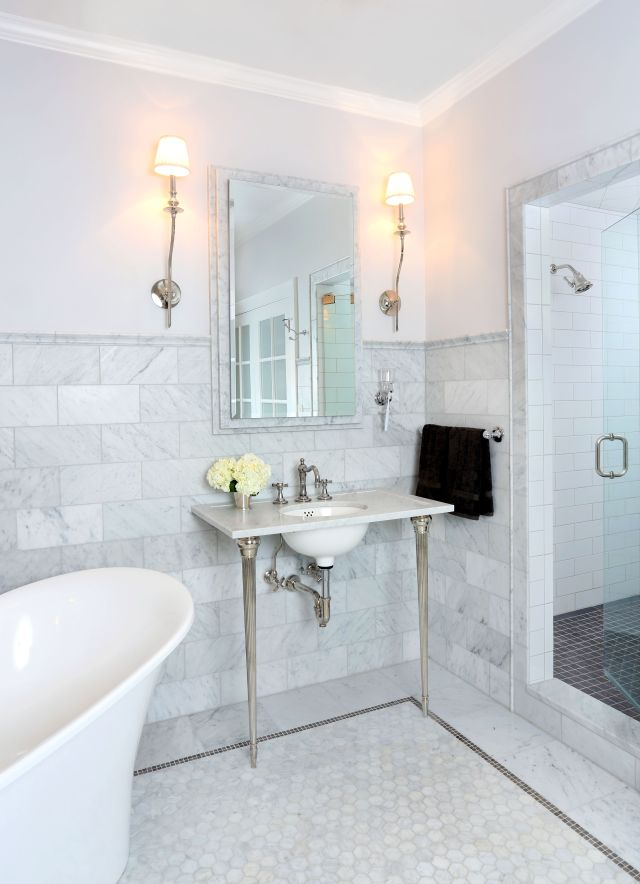 This bathroom is the ultimate spa like retreat with Carrera marble