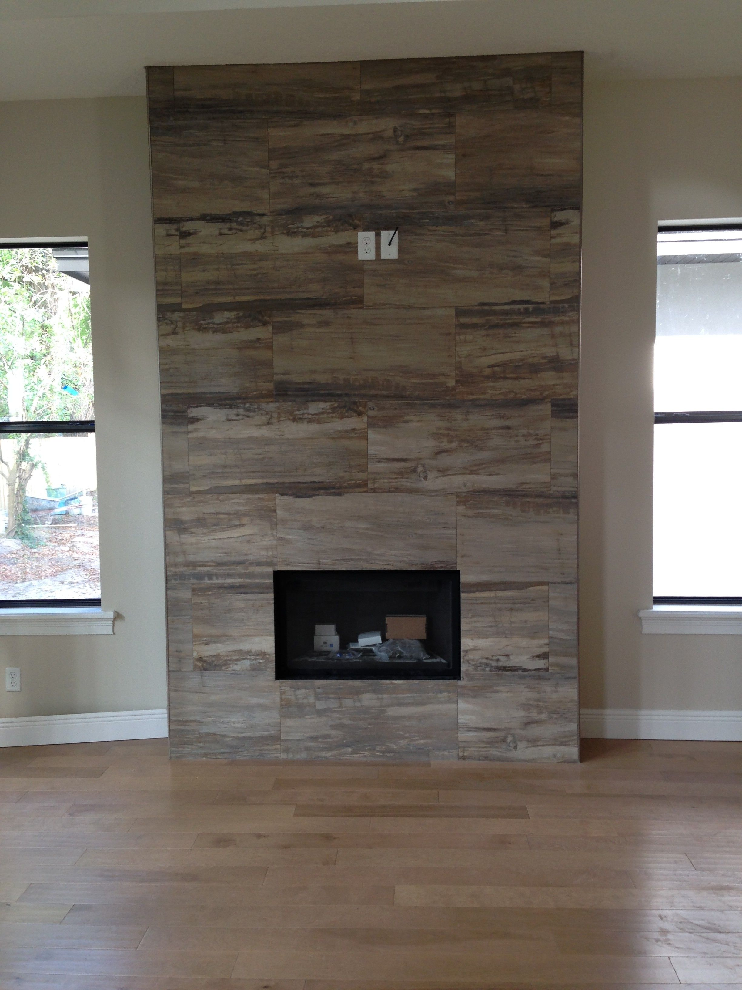 J Wood Tile makes an absolutely stunning fireplace