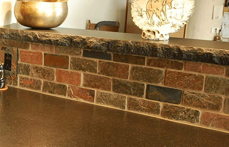 Black Absolute Granite Counters With A Chiseled Edge And