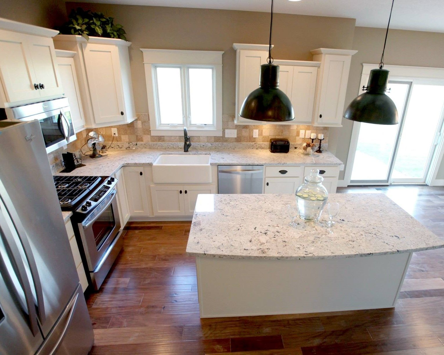 Lshaped kitchen layout with an arched overhang on the