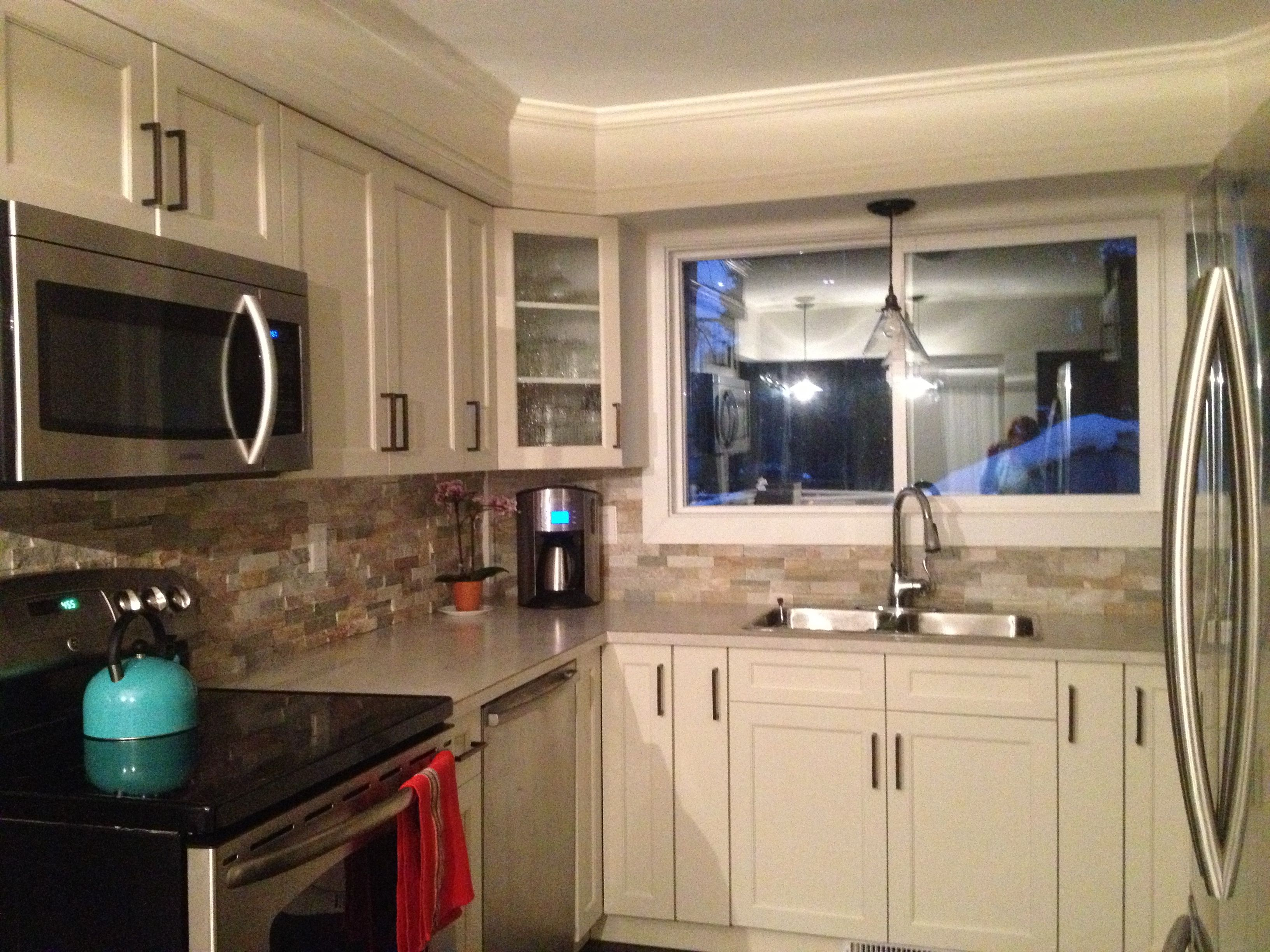 Antique white kitchen with brushed bronze pulls and