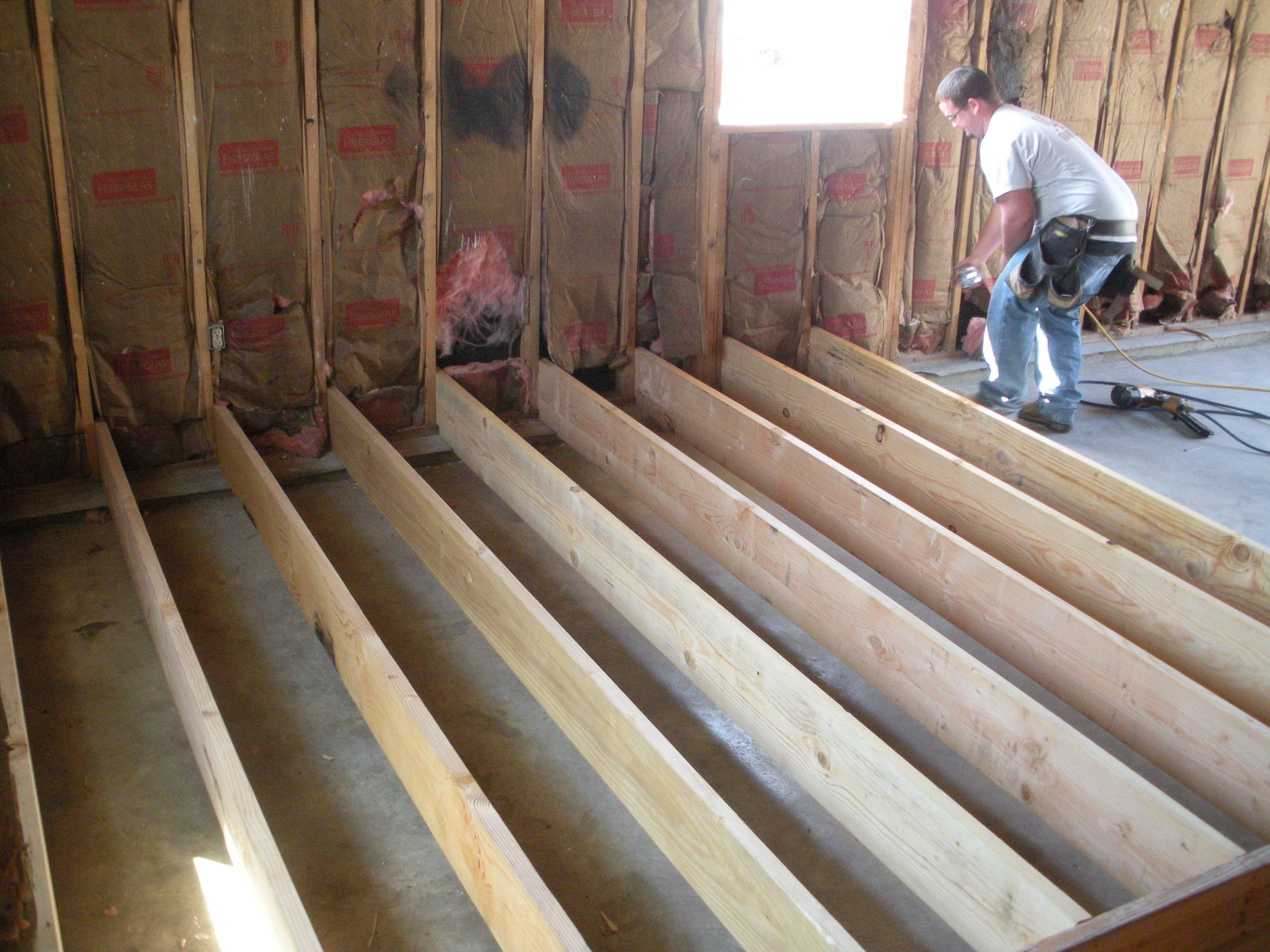 New subfloor goes down!! Level walk out to new living