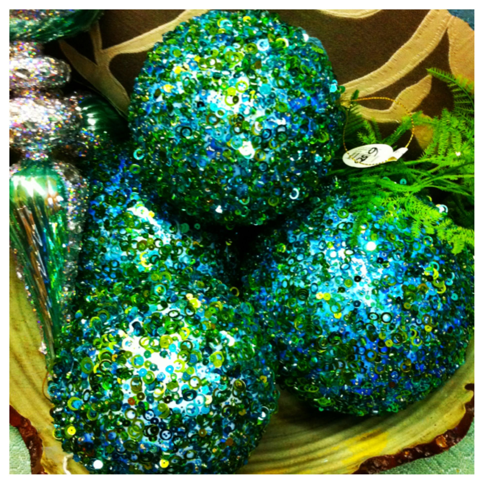 use beads, glitter, and sequins to decorate styrofoam