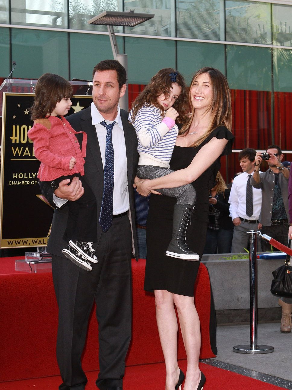 Adam Sandler with his wife and children walk of fame My
