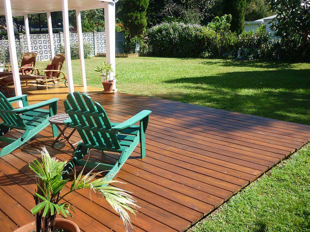 Here's a backyard ground level deck. landscape