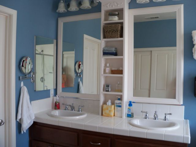 Framed bathroom mirror My husband did this one Built the shelves