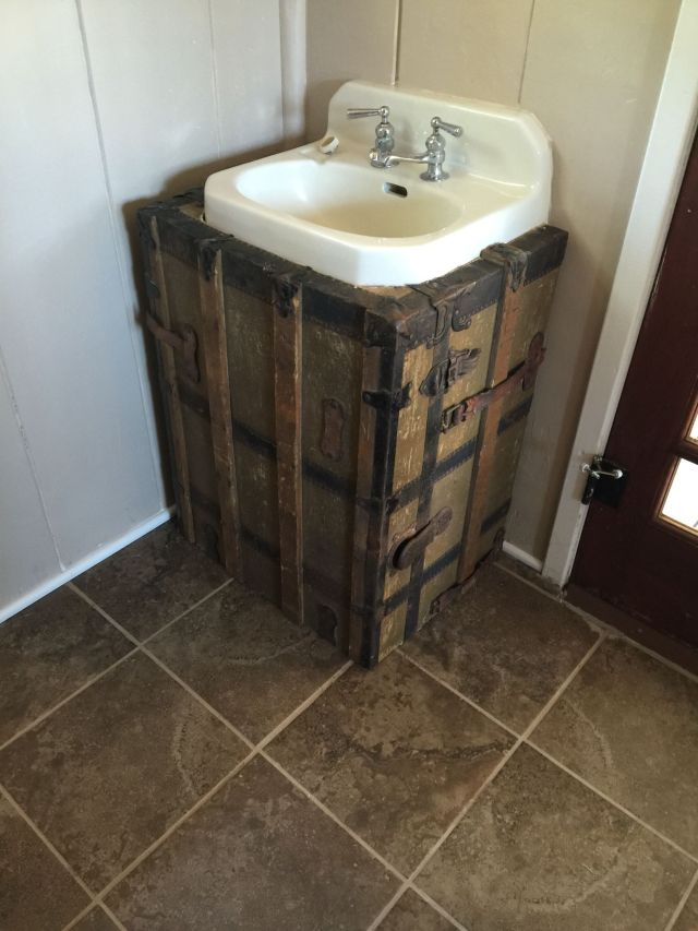 Ugly sink with visible piping Not today Cover them up with an