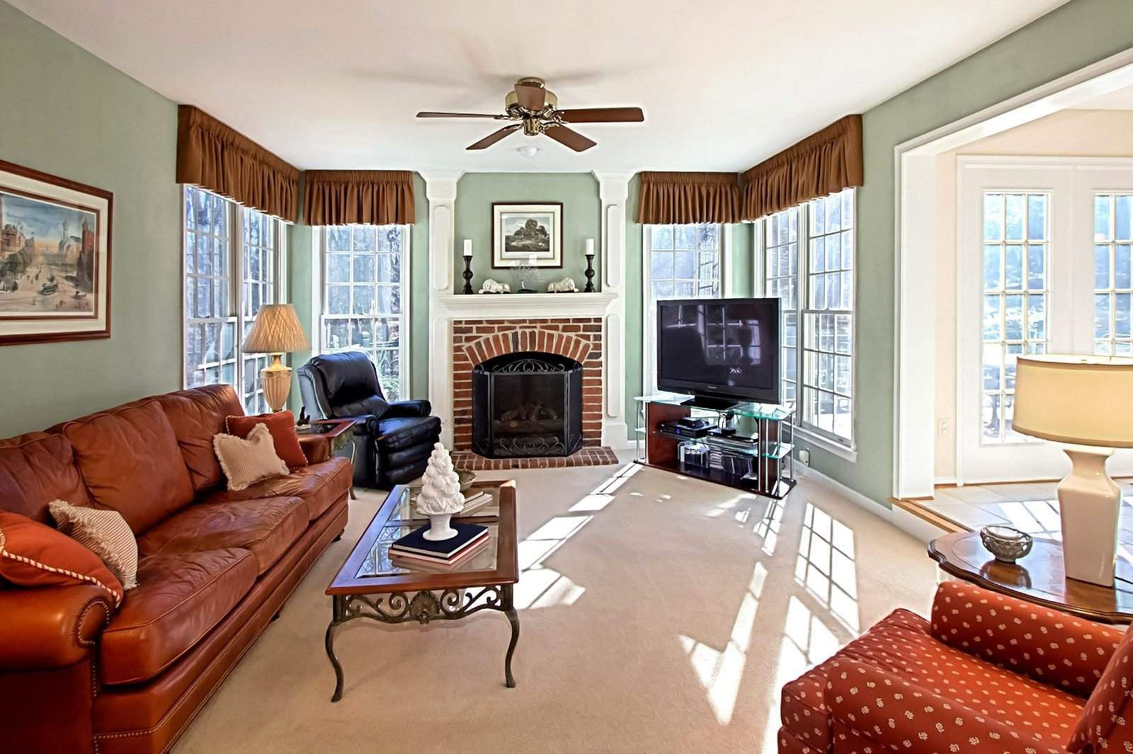 rooms with red brick fireplaces | open foyer impresses in fairfax