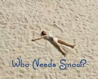 Woman making a snow angel on the beach