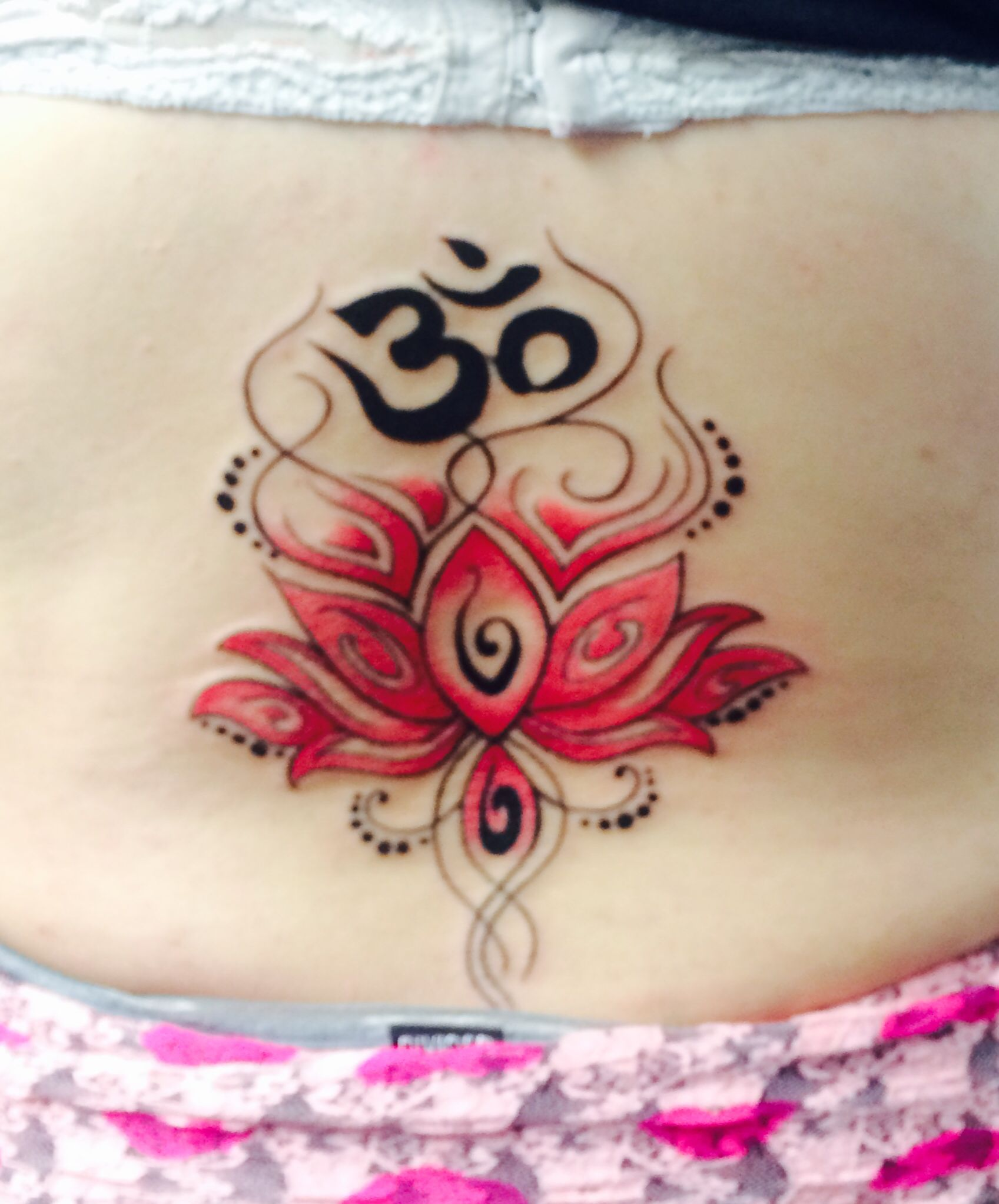 Pink lotus flower lower back tattoo! Ohm at the top