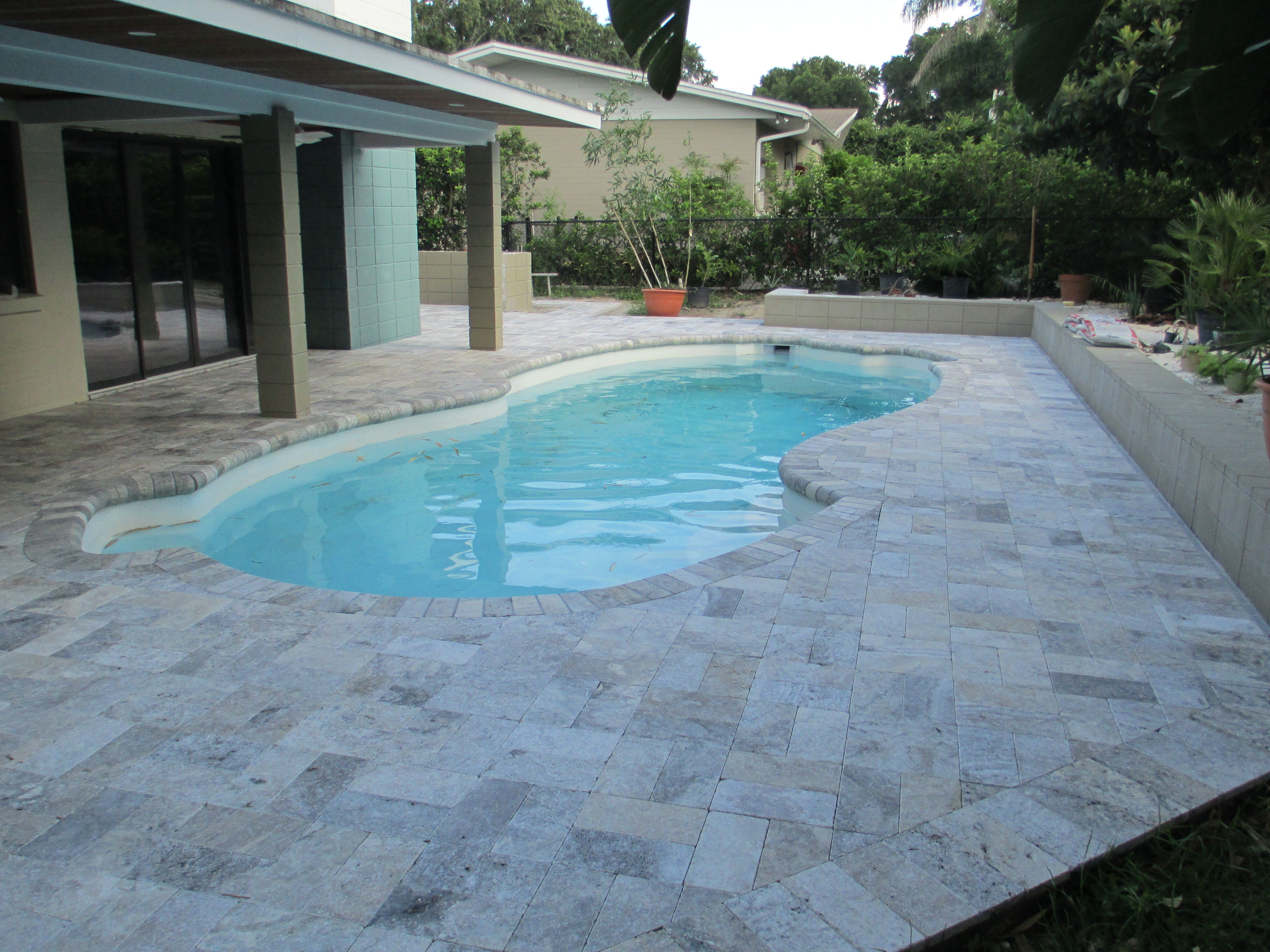 Painting of Falling in Love with Travertine Pavers Pool