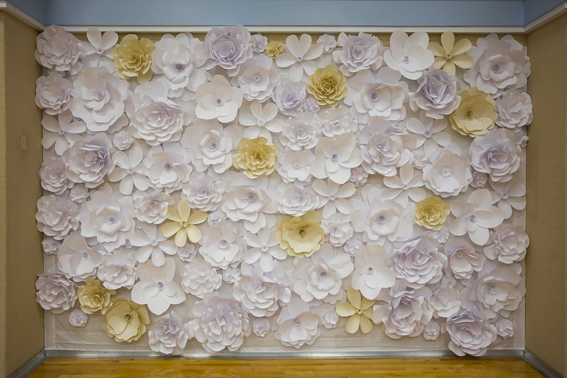 Beautiful paper flower wall for wedding reception! We put