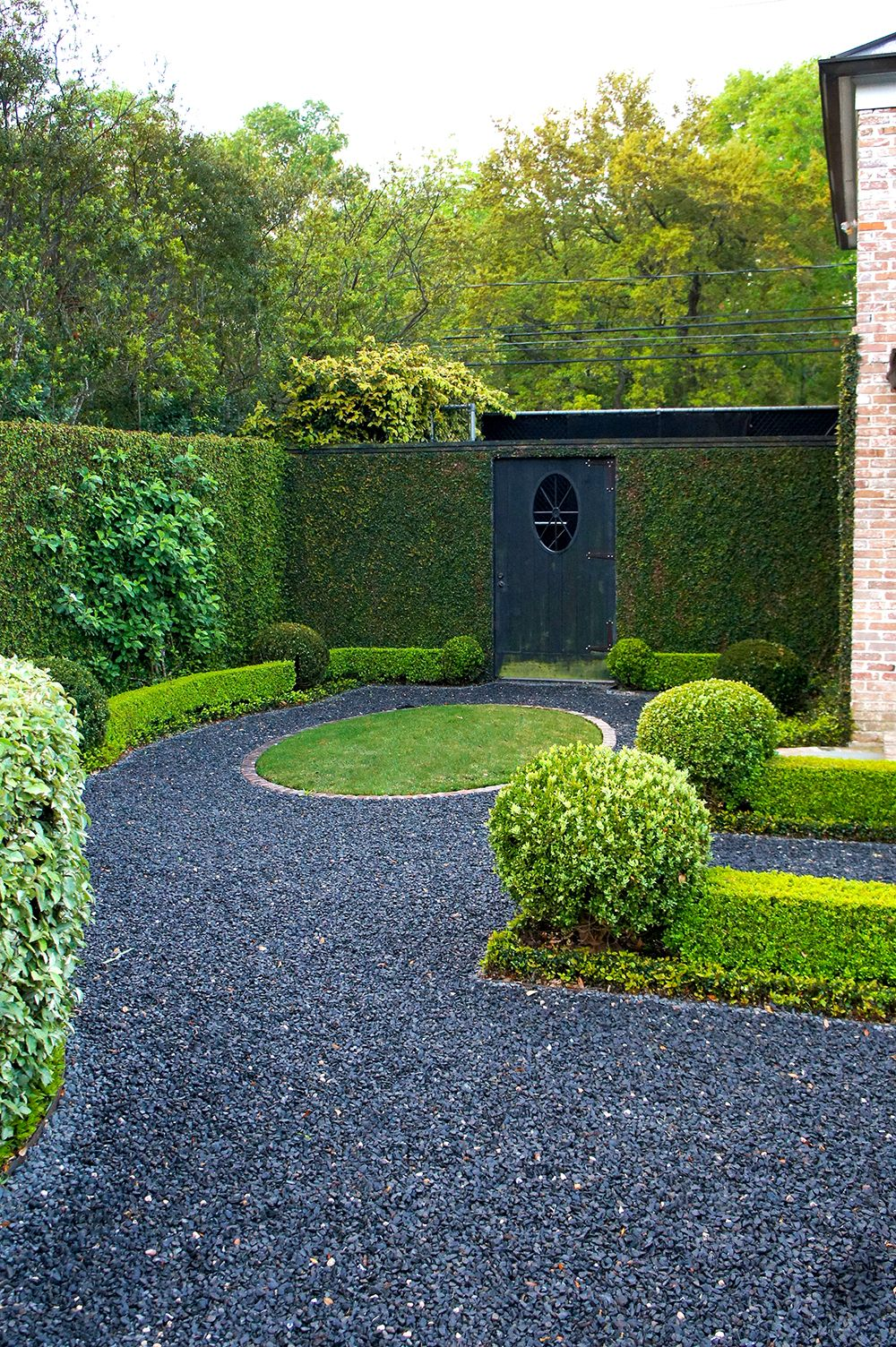 Behind the private driveway is a blackstar gravel path