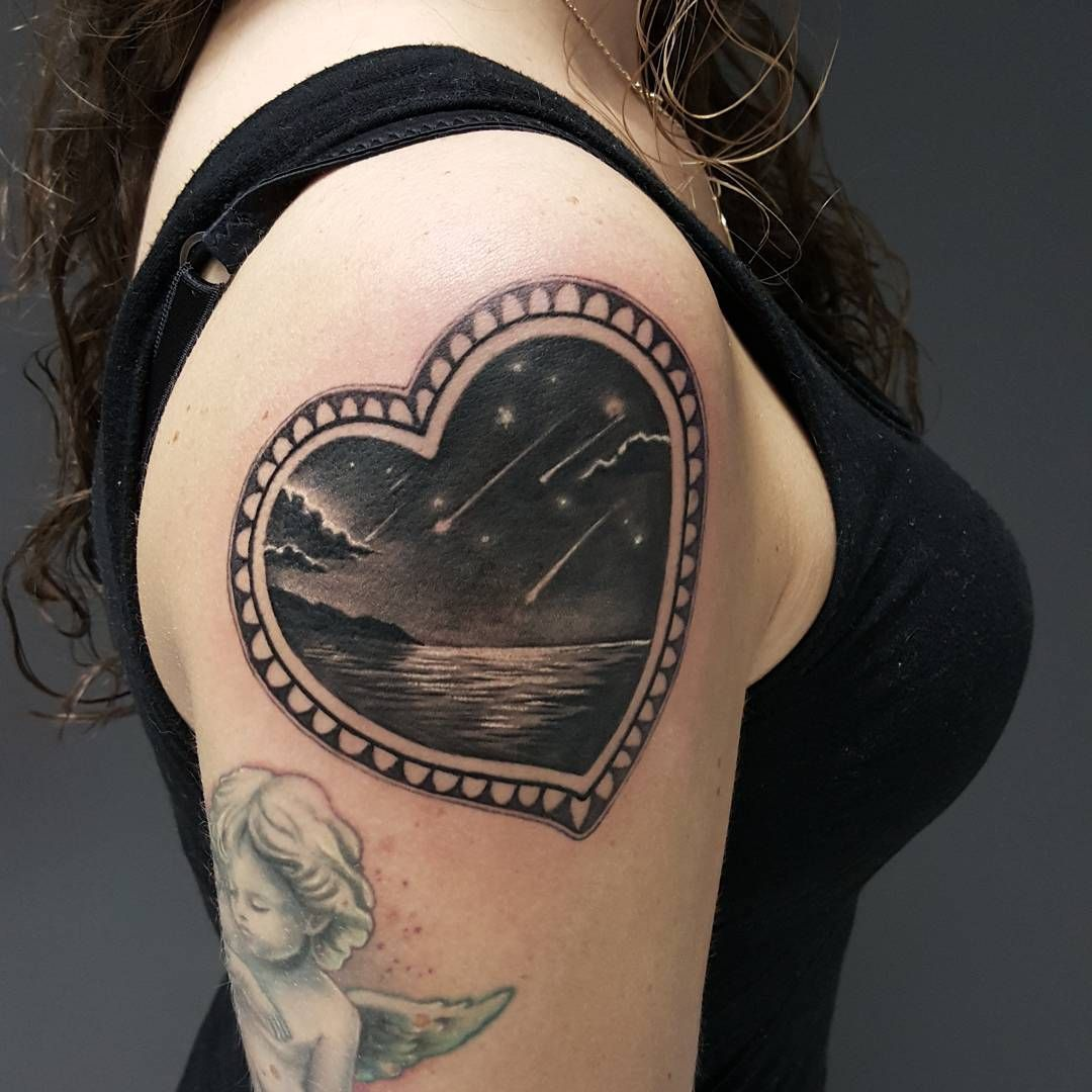 heart shaped frame and seashore and falling stars inside