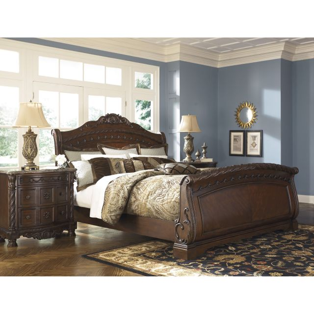 Signature Design by Ashley North Shore Dark Brown Sleigh Bed by