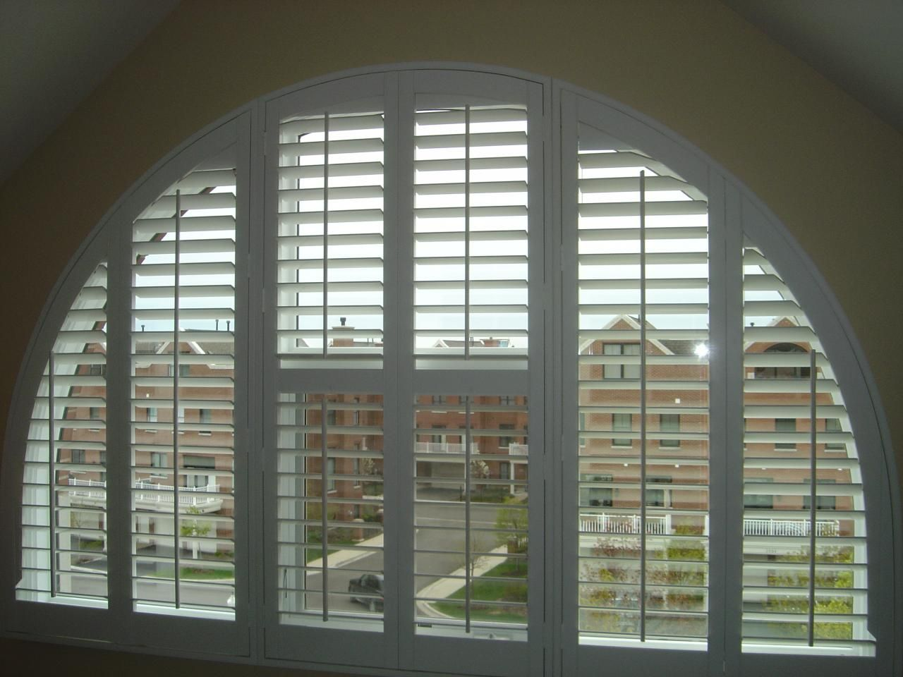 This arched window is adorned with white plantation