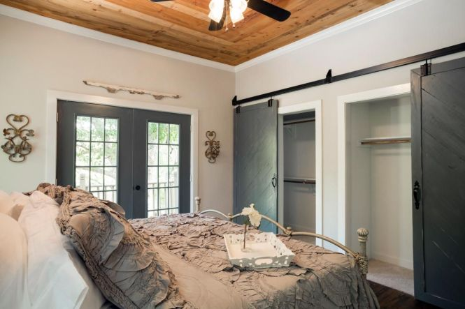 Master Bedroom With Wood Paneled Ceiling And Sliding Barn Closet Doors The Functional Seen Here Opened To Reveal His Hers Closets
