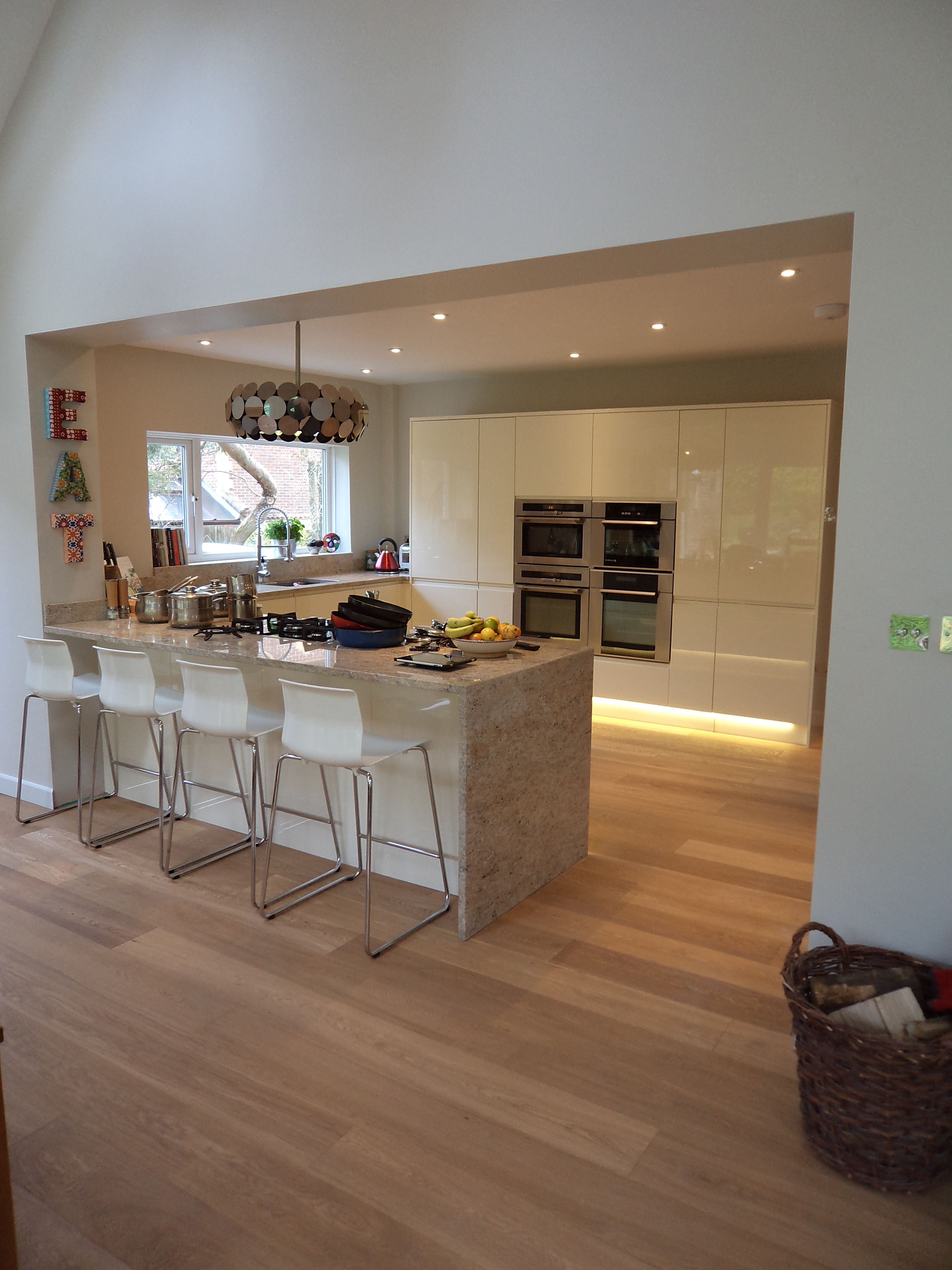 This stunning Handleless White Kitchen is perfect in this