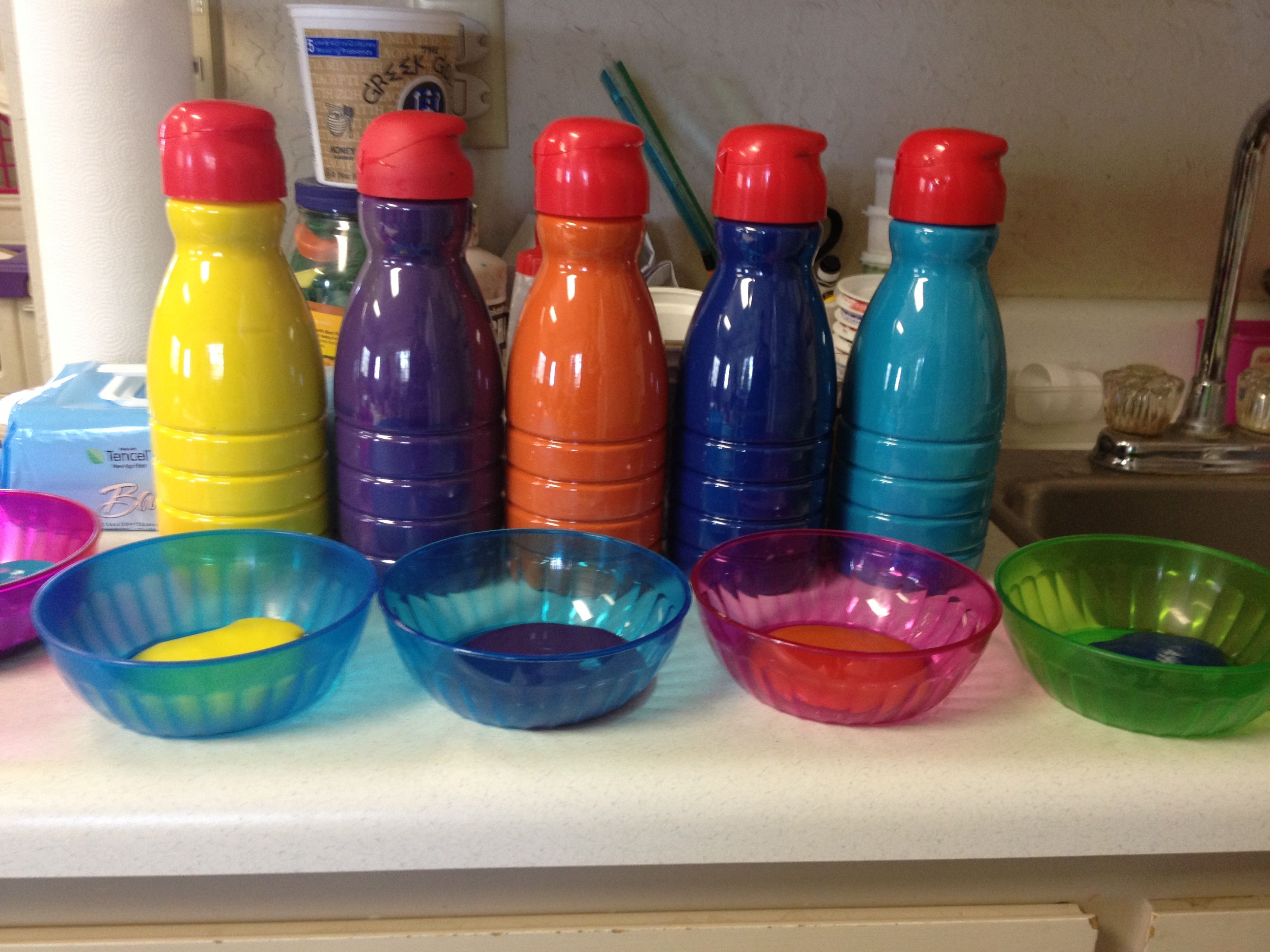 great way to use old coffee creamer bottles. keeps paint