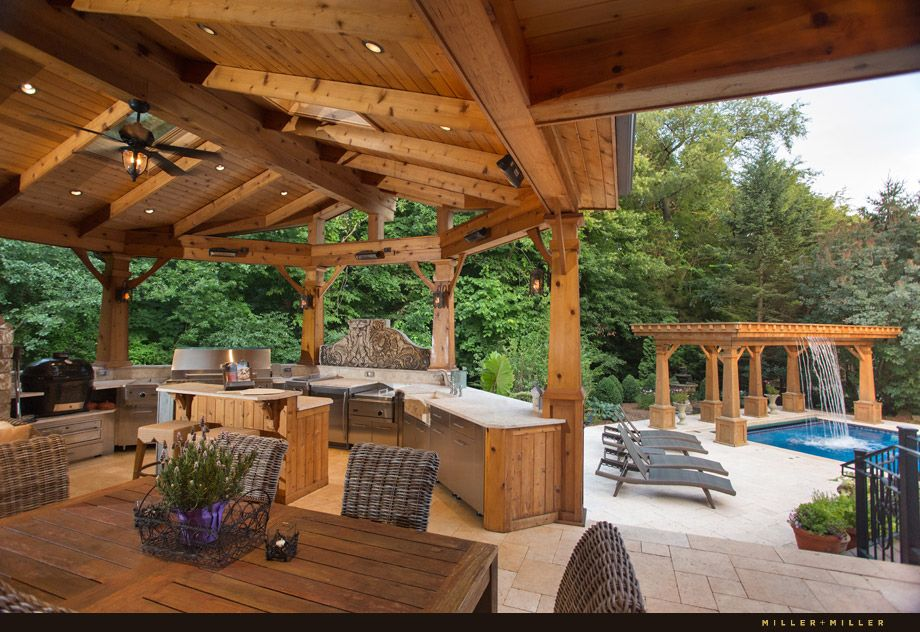 Outdoor kitchen next to the pool. Cascading Waterfall into