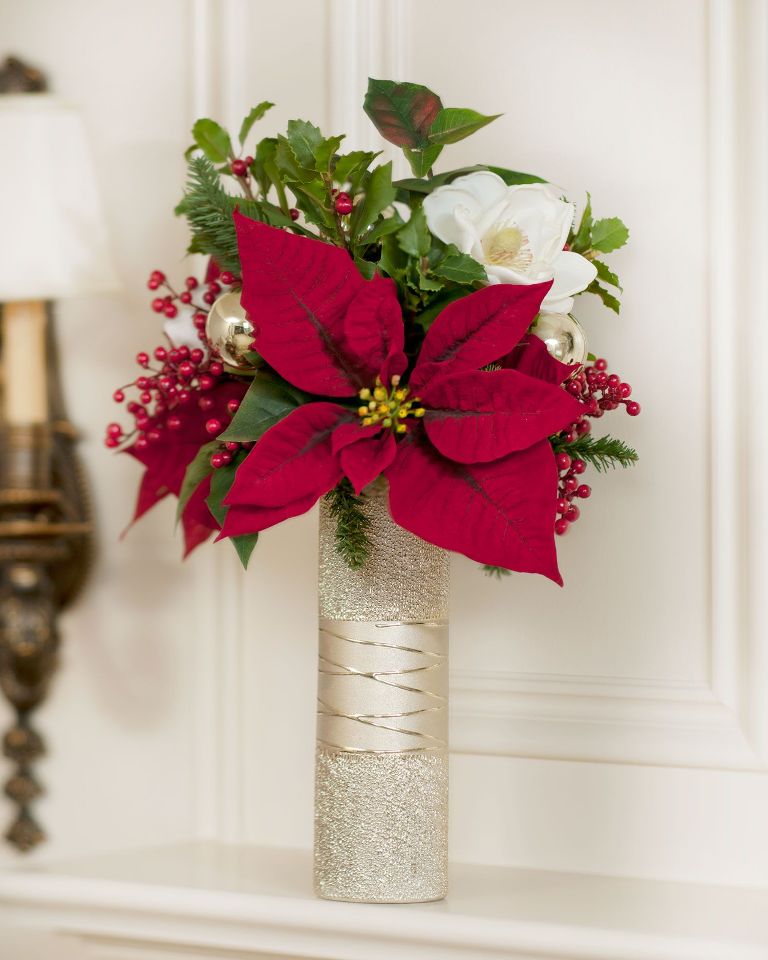 Deep red poinsettias and creamy white magnolias combine