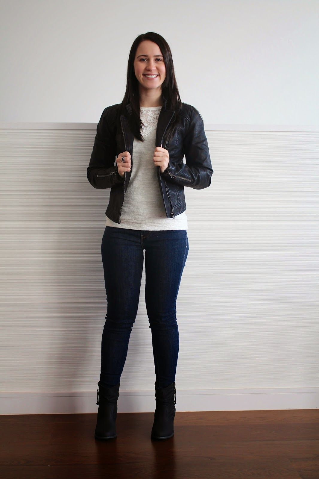 Winter neutral outfit jeans, cream jumper, leather jacket