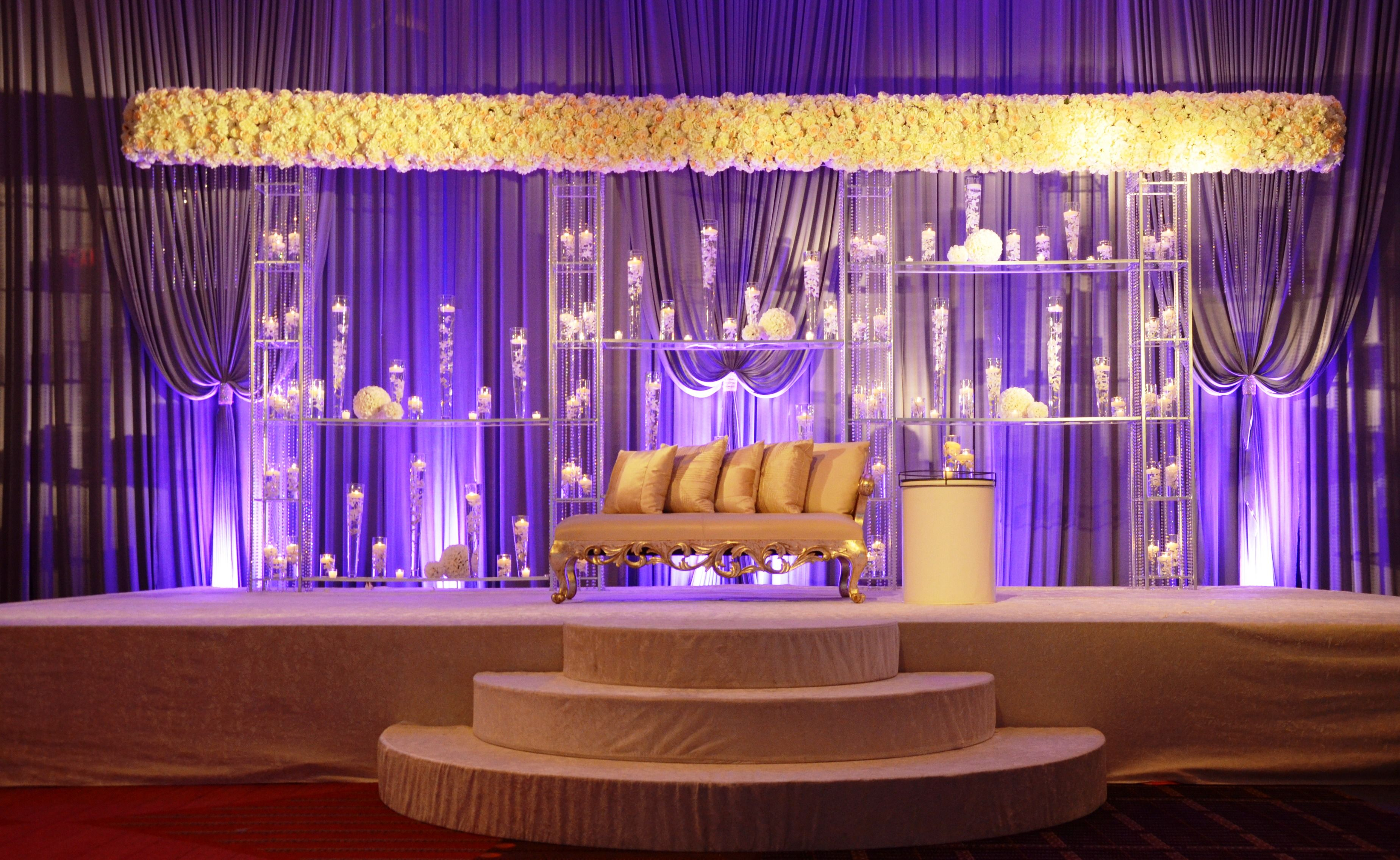 Modern Indian wedding ceremony with wide all floral mandap