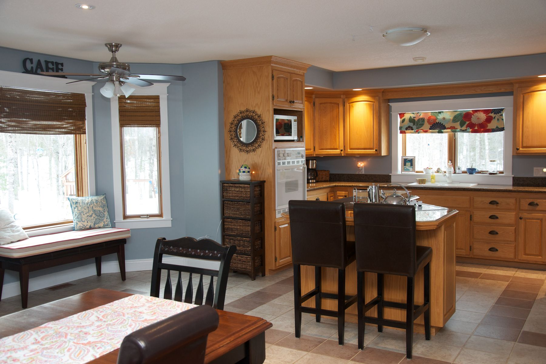 Oak Kitchen with Blue/Grey Wall color. Kitchen reno is not