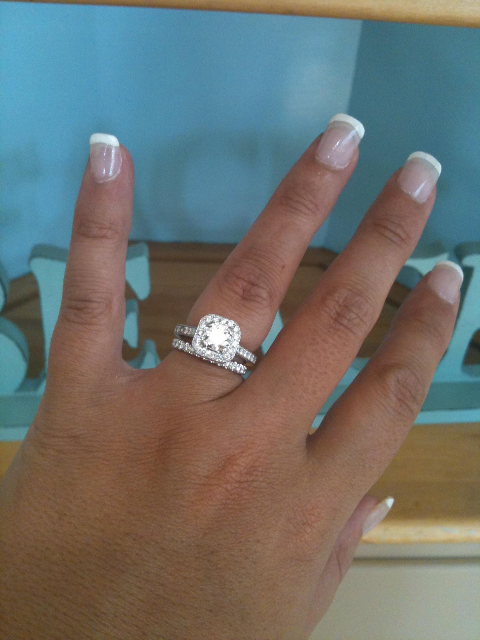 Round diamond inside square diamond ring. Wedding rings