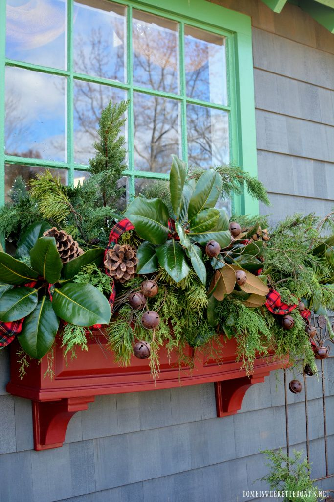 Sprucing up the window boxes for Christmas with greenery