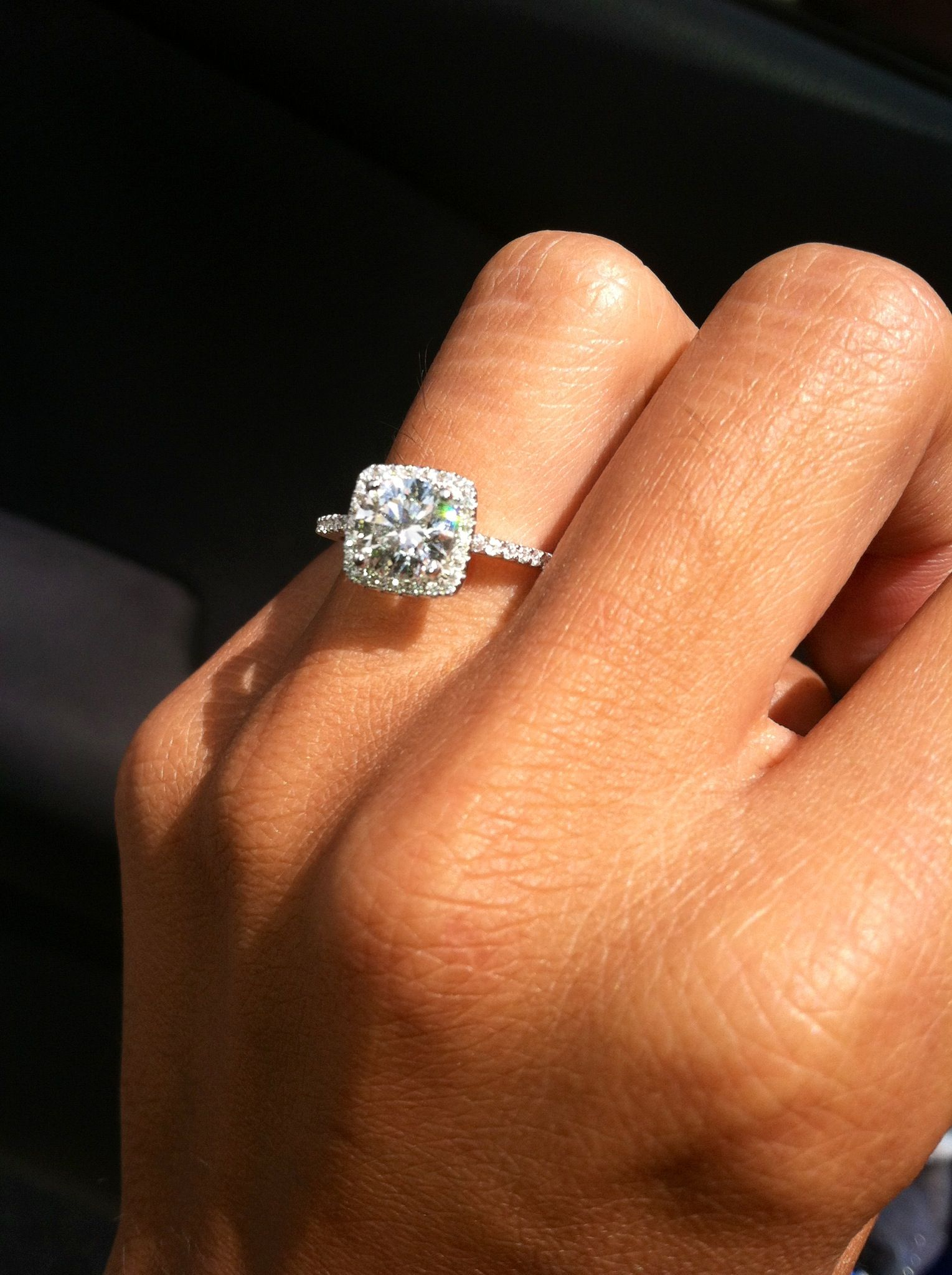 Cushion style halo engagement ring with pave diamonds and