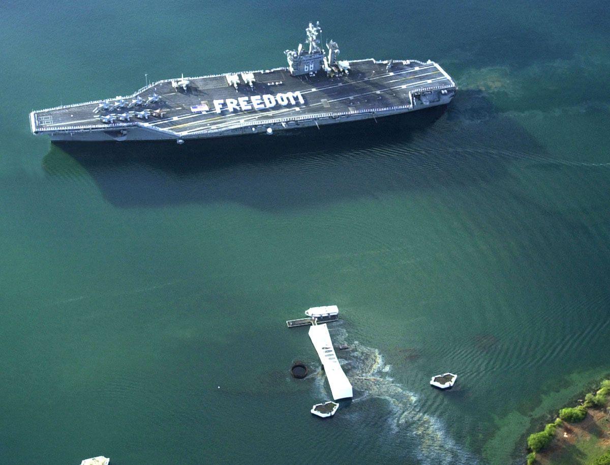 CVN68 (aka, USS Nimitz) passing by the USS Arizona
