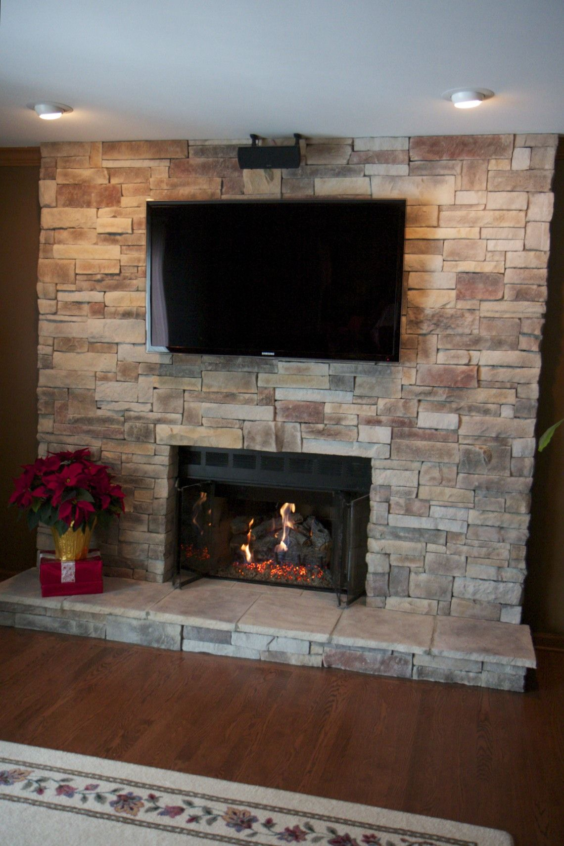 Ledge Stone Fireplace With Tv Located In Lake Zurich