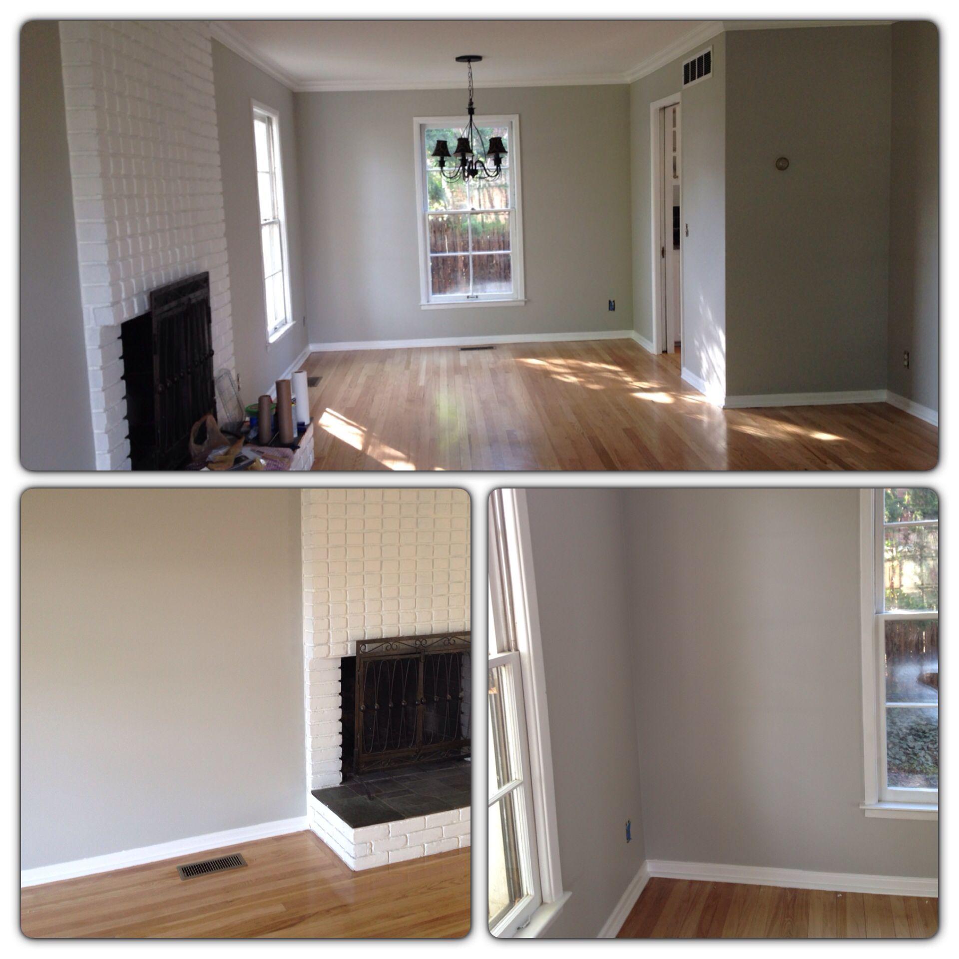 Light gray walls with light oak hardwood floors. Wall