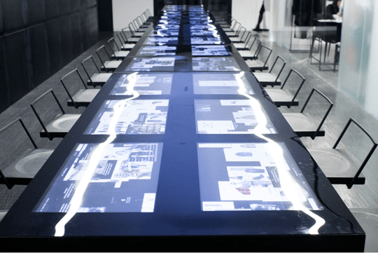 Screens built into the conference table. Posted by NYC