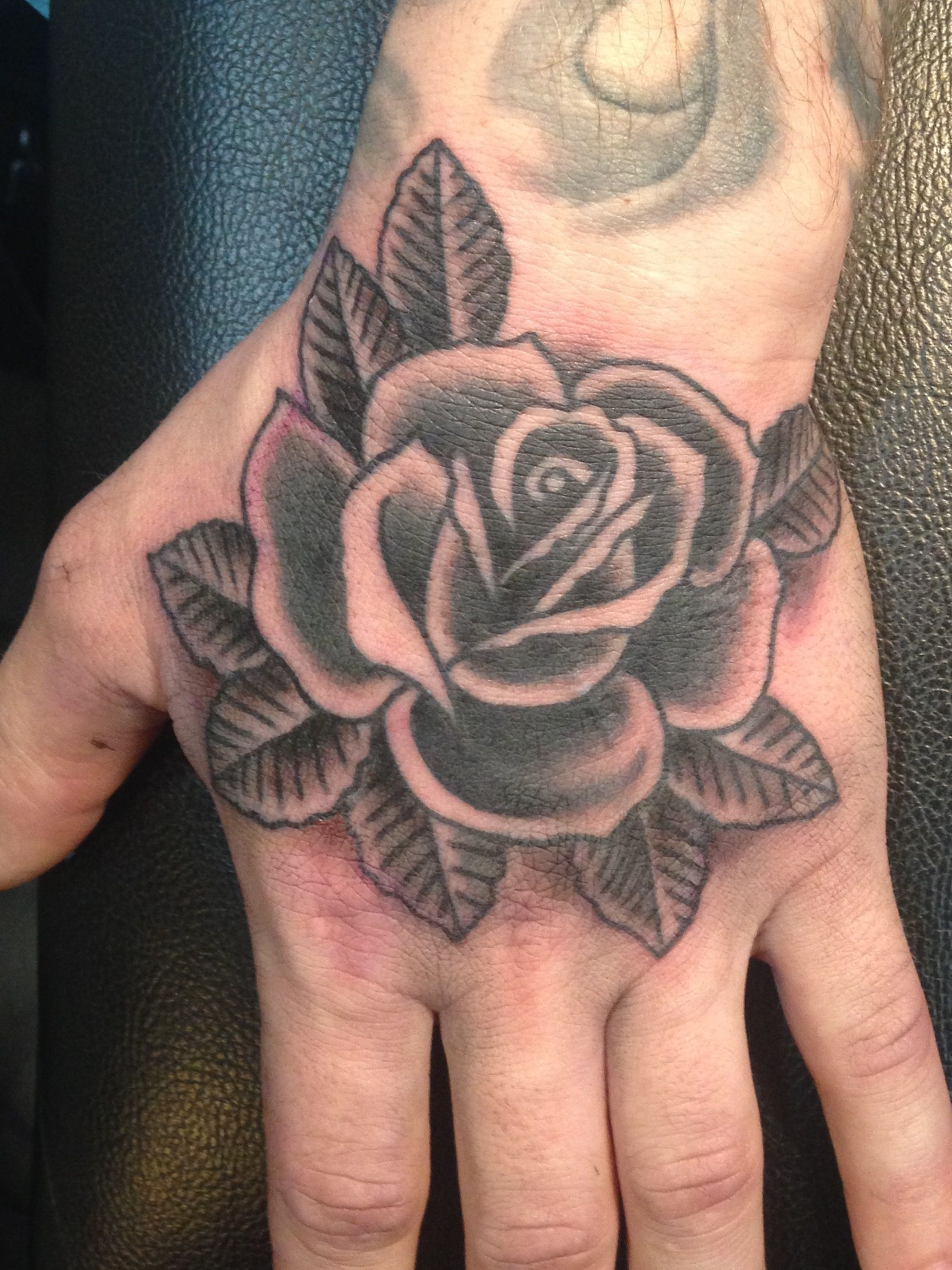 Traditional black and grey rose hand tattoo by Sara Purr