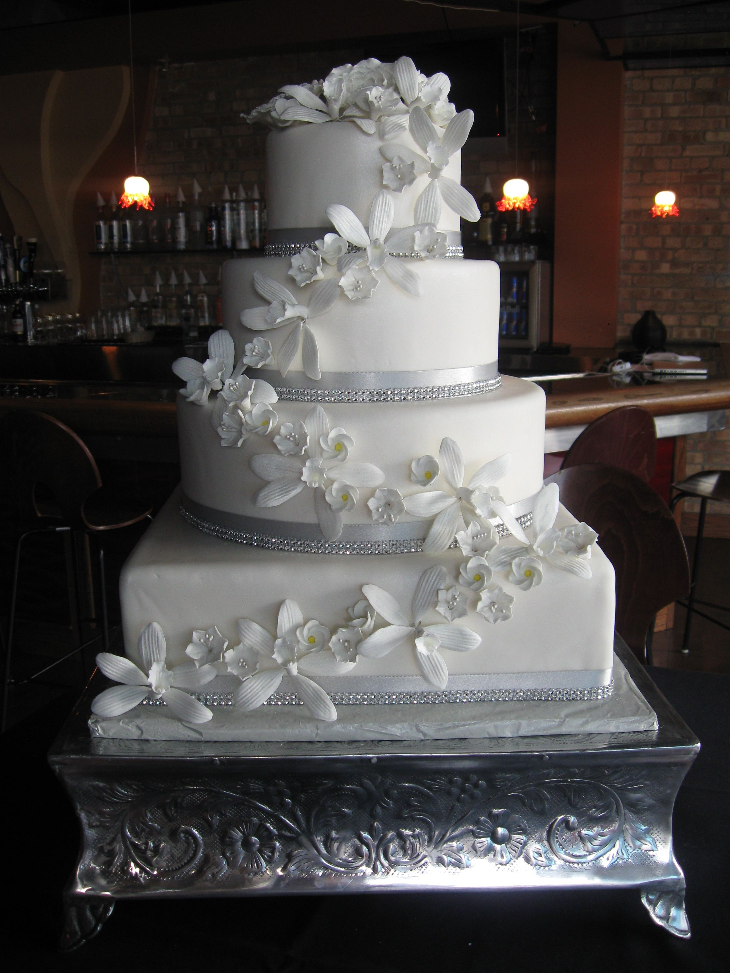 White Wedding Cake With Rhinestones And Orchids Possibly