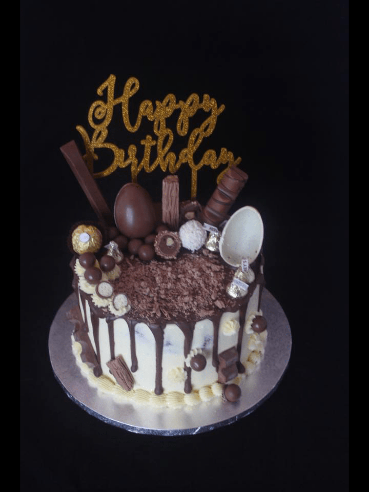 Chocolate Drip Cake With Lots Of Yumminess On Top