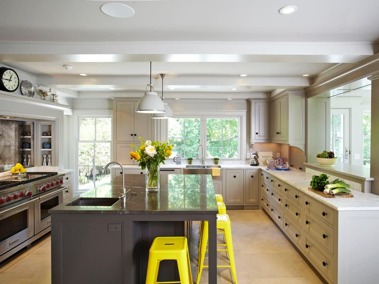 a long counter of drawers with no upper cabinets allows the owners