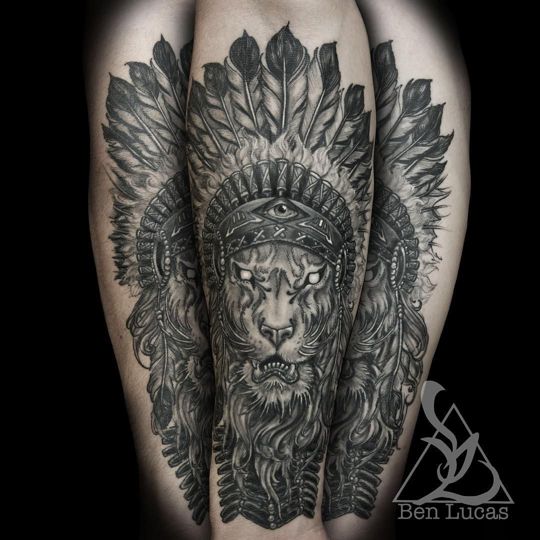 Brandon's lion with Indian headdress on his forearm. . I