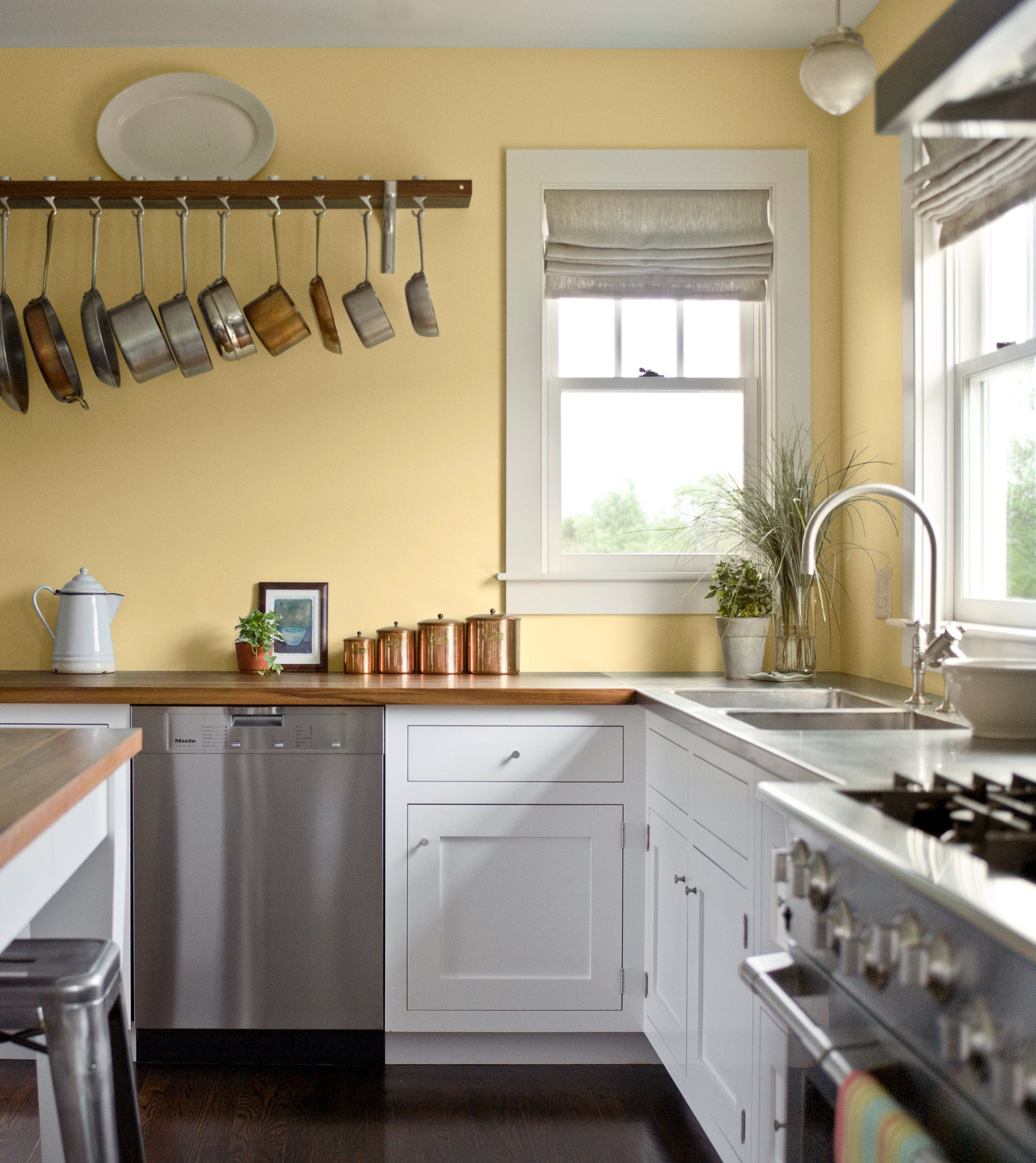 Pale yellow walls, white wood counter tops