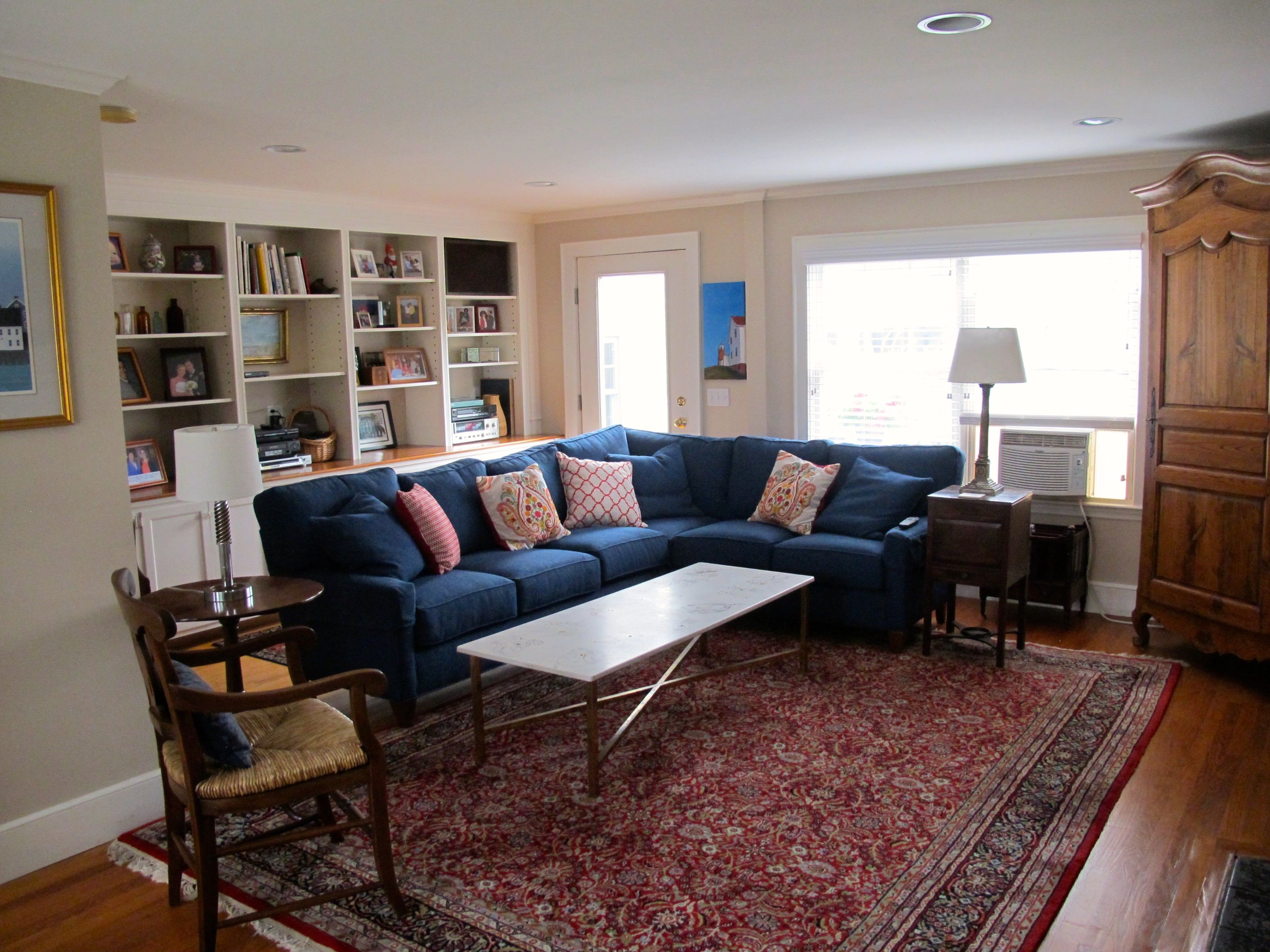 i love this blue sofa with the red persian rug. living room done