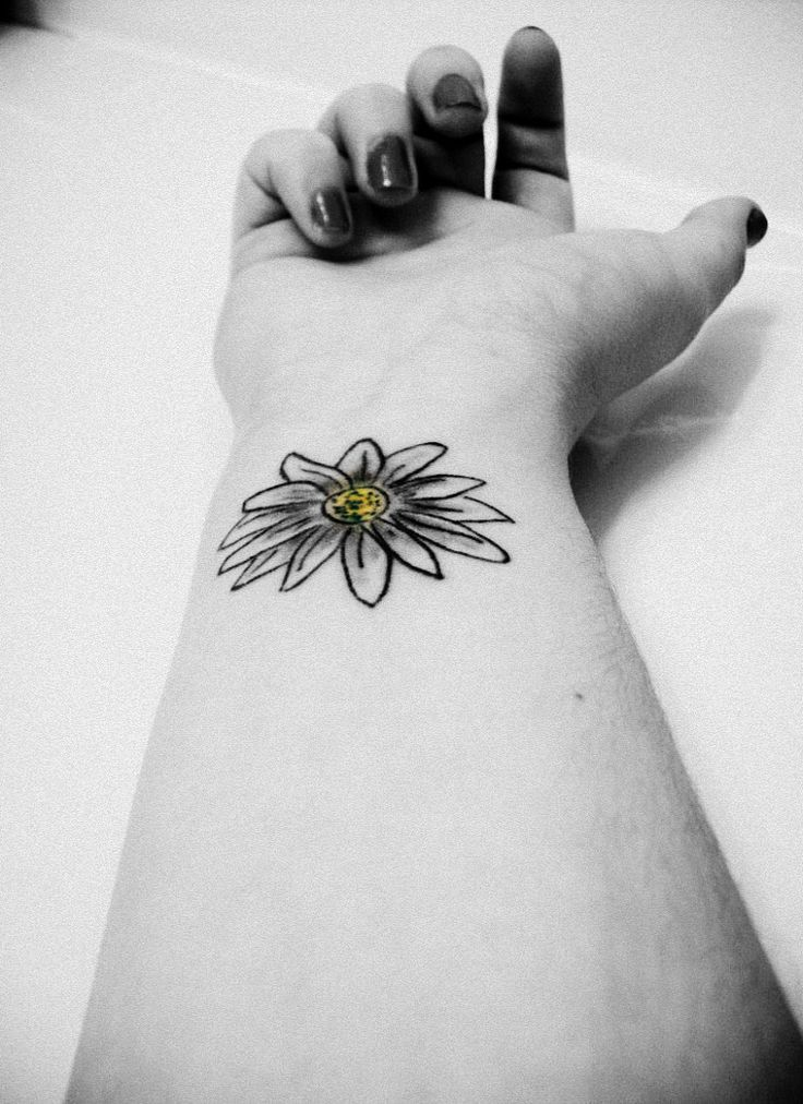 Black And White Daisy Tattoo On Girl Wrist daisy tattoos