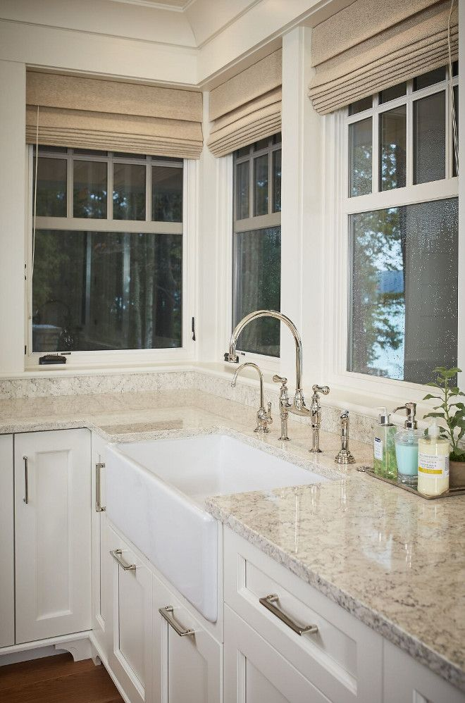 Durable white granite countertop with farmhouse sink