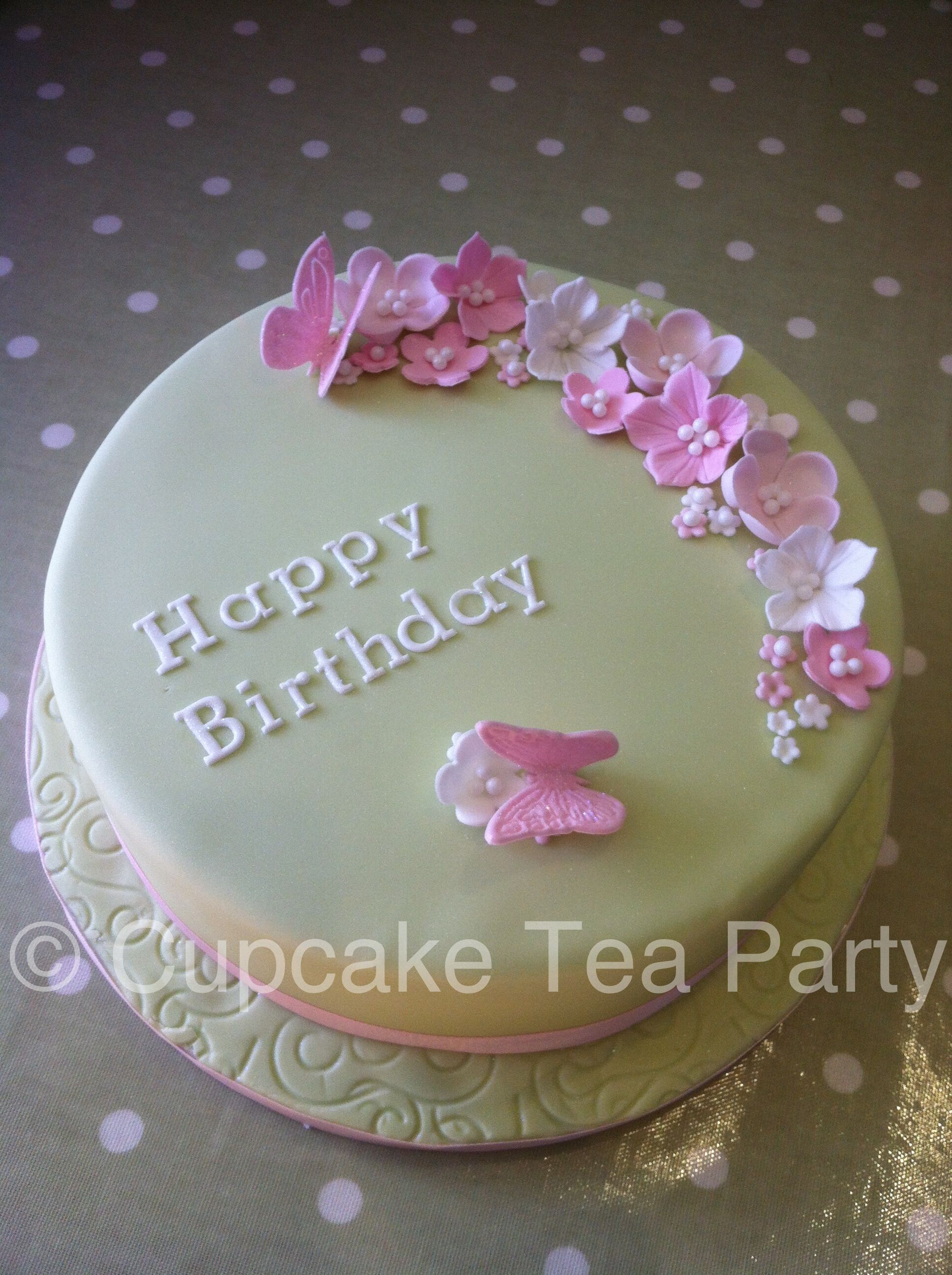 Flowers and butterfly birthday cake. www.cupcaketeaparty