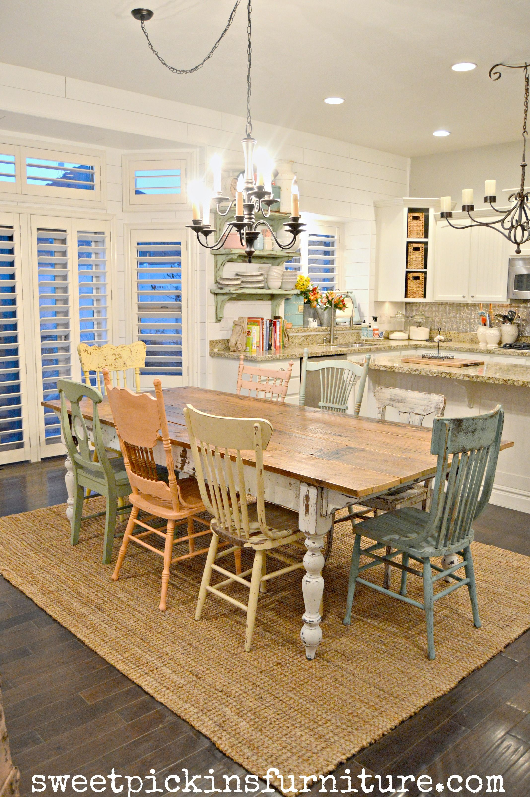Farmhouse table and mismatched chairs painted with sweet