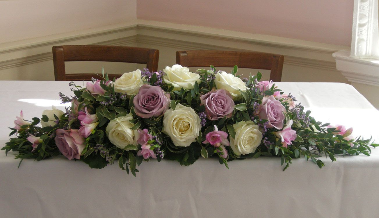 ceremony table flower arrangement of ivory Avalanch roses