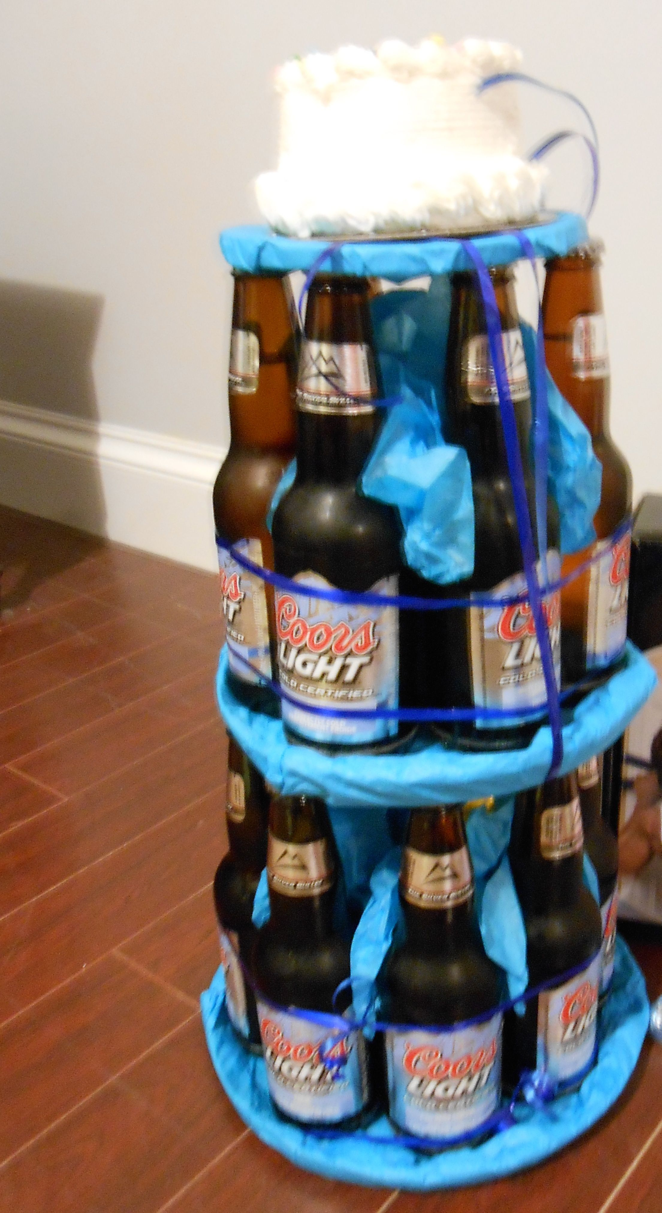 Beer Cake Idea Wrapped With Ribbons And Topped With A
