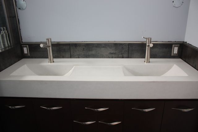 A double Eclipse Concrete Vanity Top The recessed area between