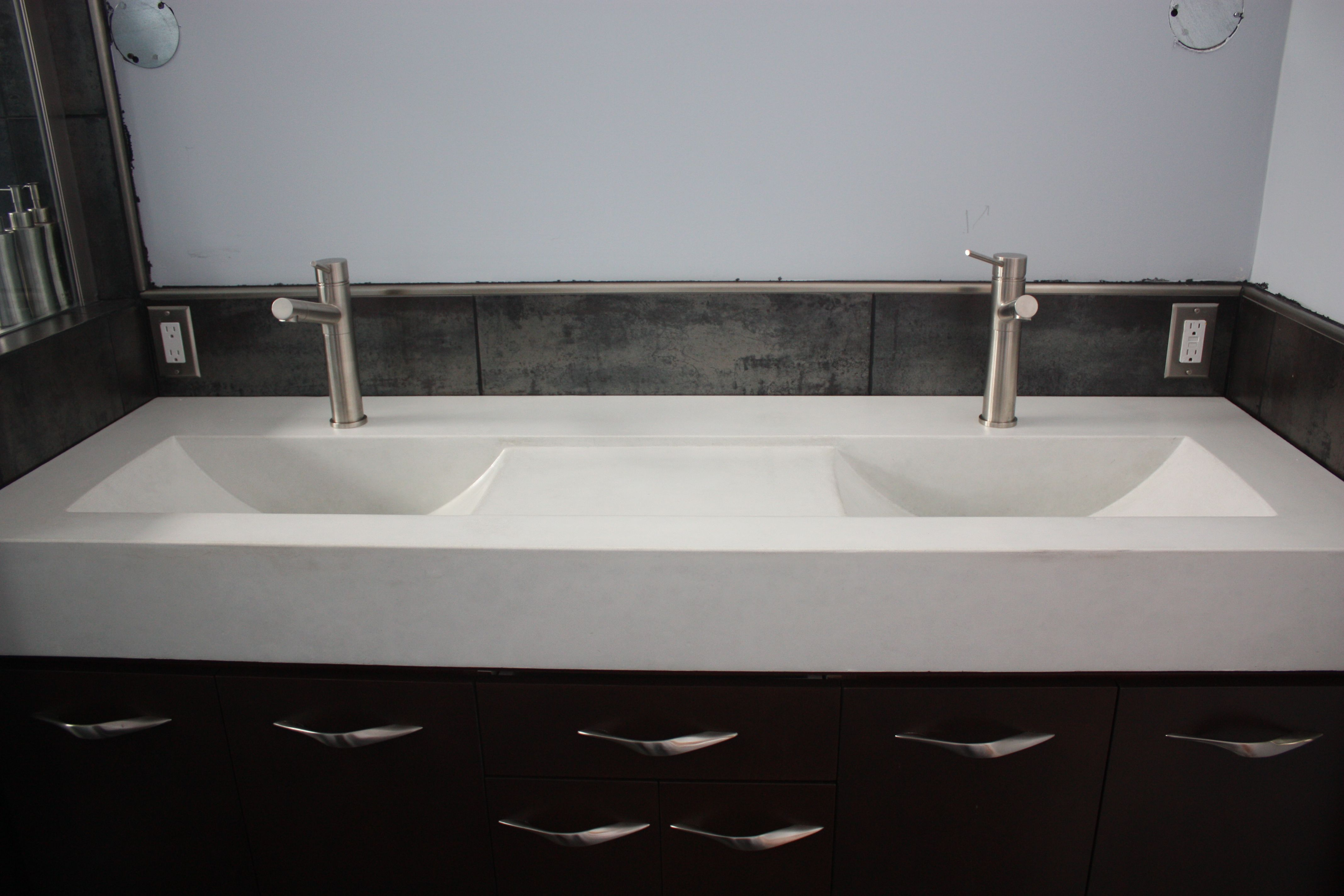 a double eclipse concrete vanity top. the recessed area between